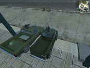 The Guerilla's patrol vehicles -Shimizu Tumbleweed- and -Hurst Buckaroo- together side by side, side view from behind.