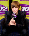 Justin promotes My World 2.0 at the Q102 radio station