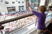 Justin Bieber waving to his fans at the Nintendo World Store