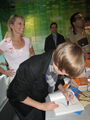 Justin autographing 'Today's Moms' book at The Today Show 2009