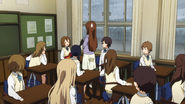 Yui with her guitar in class