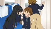 Mio and Yui headbang
