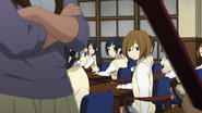 Mio and the others looking at Yui
