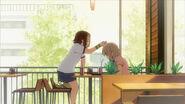 Ritsu chops Mugi