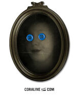 Katie Sandow with blue buttons on eyes picture