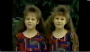 16. Two Girls Twin brown shoes and red pants zoom up Girls Two Twins Amercian shirt eyes and hair
