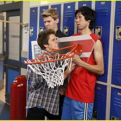 Spike puts other students up against the lockers