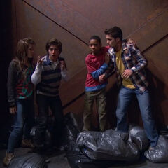 Adam, Bree and Chase trying to get Leo out of the recycling center