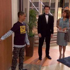 Leo opening the door for Donald and Tasha