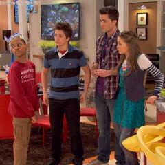 Leo, Adam, Bree and Chase looking at Tasha