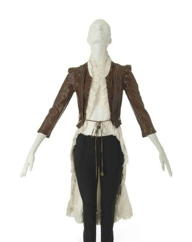 File:A brown leather jerkin with white cotton drill tails alexander mcqueen d5583364h.jpg