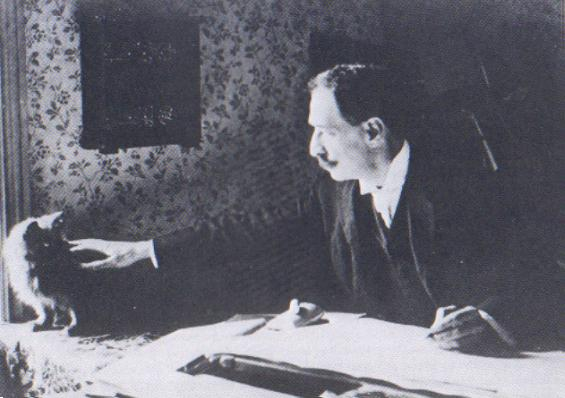 File:Louis Wain at his drawing table 1890.JPG