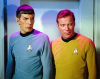 Captain kirk and spock look on