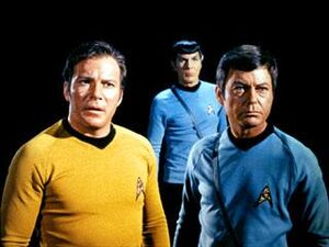 Captain kirk spock and mccoy look on