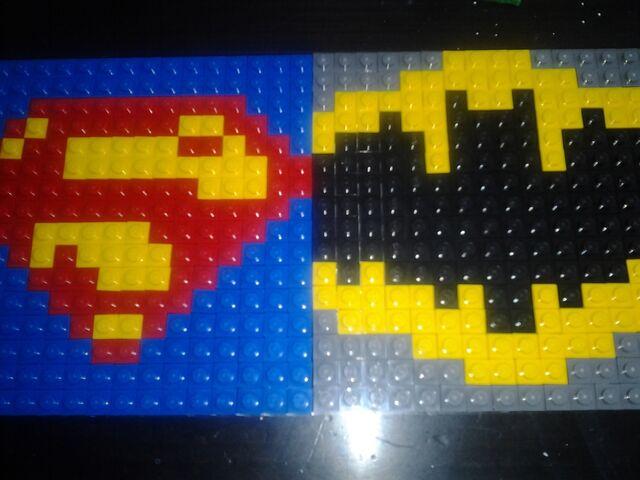 File:Batman and Superman Shields Event.jpg