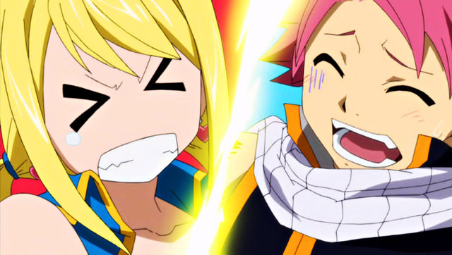 File:Natsu steps on Lucy while dancing.jpg
