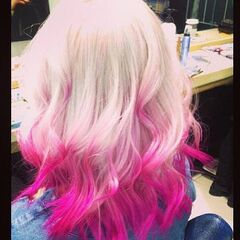 Perrie's wavy pink angled, two tone hairstyle