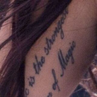 "On the inside of her upper right arm are the words ""Music is the strongest form of magic."""