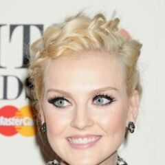 Perrie's straight golden blonde crown braided, updo hairstyle