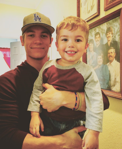 File:Lucas with his Nefew.png