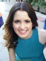Laura Marano wearing a blue dress