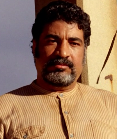 File:5x10 Sayid's Father After Chicken Death.png