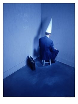 File:386410abusinessman-sitting-in-corner-with-dunce-hat-posters1 (1).jpg