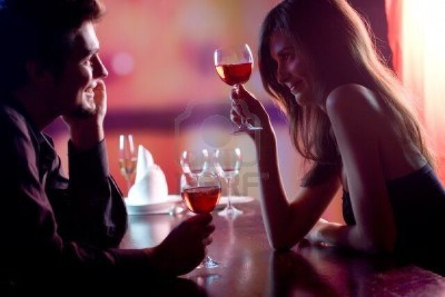 File:868281-young-couple-sharing-a-glass-of-red-wine-in-restaurant-celebrating-or-on-romantic-date-focus-on-woma.jpg