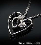 http://www.google.com/imgres?hl=en&biw=1600&bih=778&tbm=isch&tbnid=UbuwY18ZwHR_tM:&imgrefurl=http://www.whiteflash.com/about-diamonds/jewelry/more-than-a-girls-best-friend-your-wifes-favorite-anniversary-gift-887.htm&docid=eAE8T5G24SI12M&imgurl=http://pics2.whiteflash.com/articlefiles/heart-shaped-pendant-with-2-diamonds