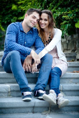 File:15141399-young-couple-sitting-on-the-stairs-and-holding-hands.jpg
