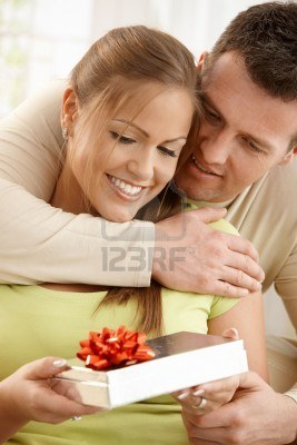File:6711726-portrait-of-happy-couple-embracing-looking-down-at-present-in-woman-s-hand.jpg
