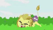 Purple Monkey pushes lion down