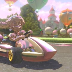 Pink Gold Peach racing her regular counterpart and Toadette.