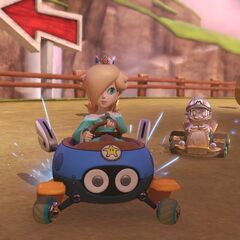 Rosalina, and Metal Mario racing on the track, while also approaching the giant egg.