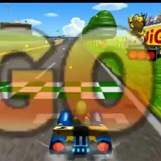 The start of the race at Luigi Raceway in <i>Mario Kart 7</i> with Luigi and Lakitu.