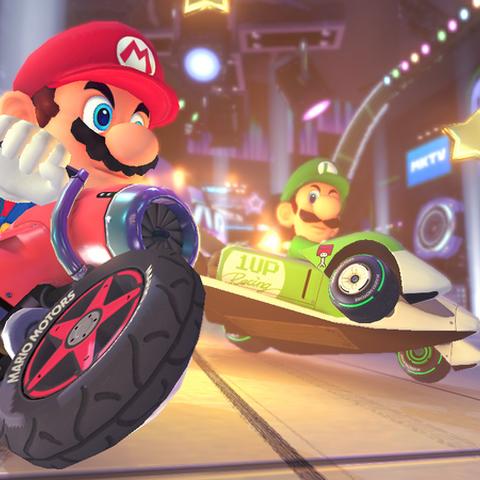 Mario, Luigi, and Yoshi racing.