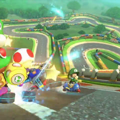Yoshi, Toad, and Baby Luigi racing on the anti-gravity section of the track's appearance in <i>Mario Kart 8</i>.