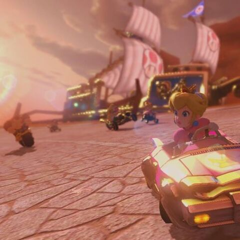 Peach, driving on the track.