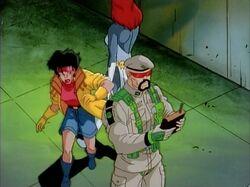 Jubilee Sneaks Behind Genoshan Commander