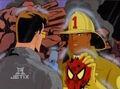 Firefighter Holds Spider-Man Mask.jpg