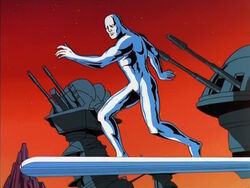 Silver Surfer Flies Past Tech World Turrets