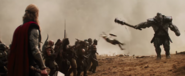 Kor thrashing Asgardian soldier