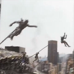 The Chitauri boards a building.