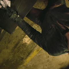 Johnny Blaze transforming into Ghost Rider.