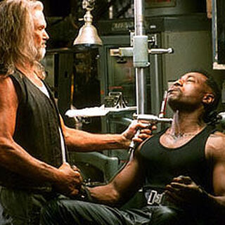 Whistler giving Blade his serum.