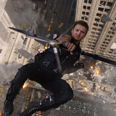 Hawkeye shoots an arrow while falling.