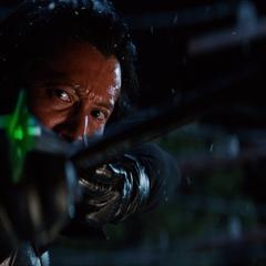 Harada aims a poisoned arrow at Logan