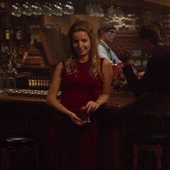 Amy waits for Charles at the bar