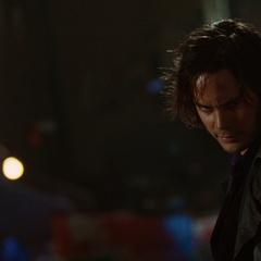 Gambit smirks at Logan