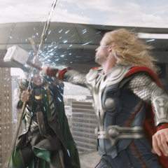 Thor and Loki fighting.